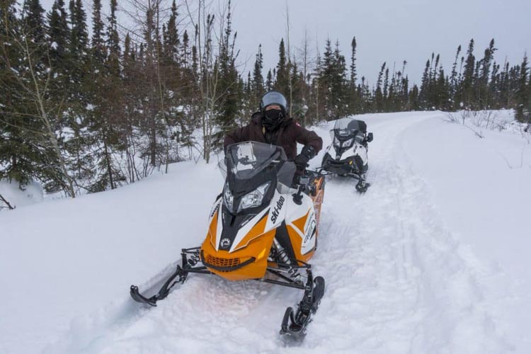 outdoor winter adventures in canada. | snowmobiling