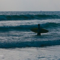 surfer-with-board-in-waves-sri-lanka.jpg