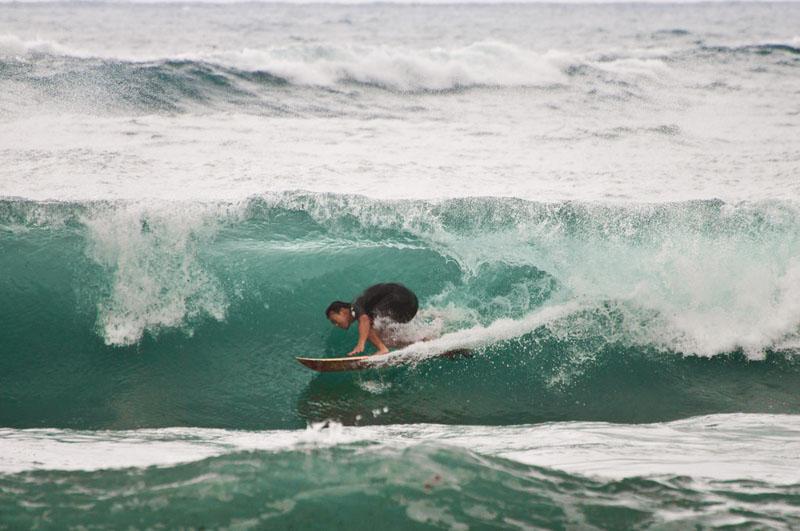 surfing taiwan under wave