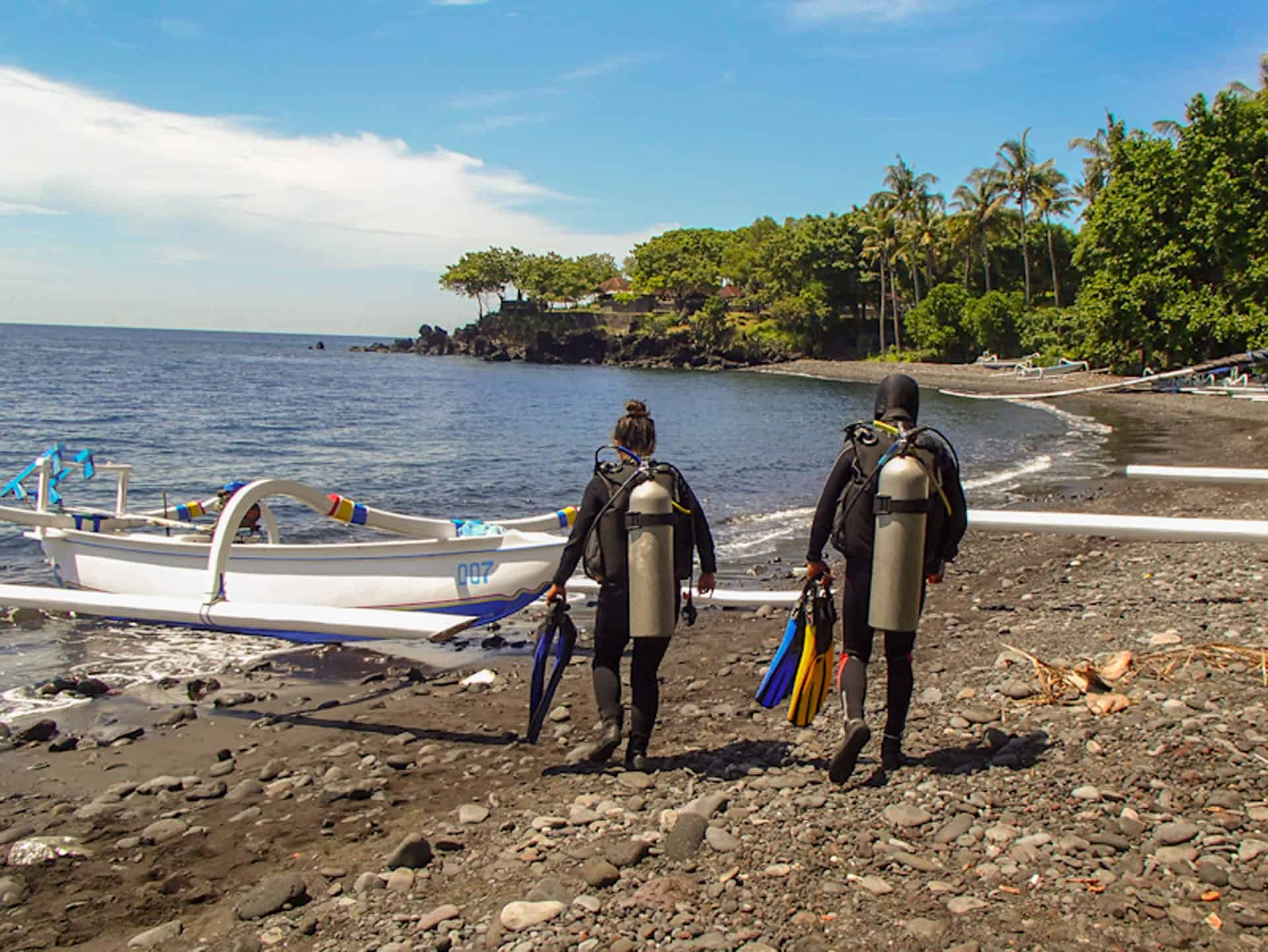divers on shore in bali