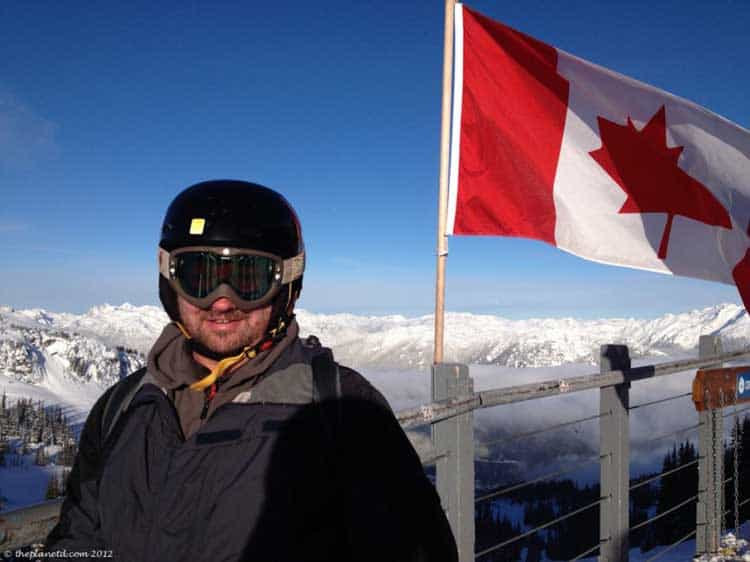 dave on mountain in whistler with canadian flag