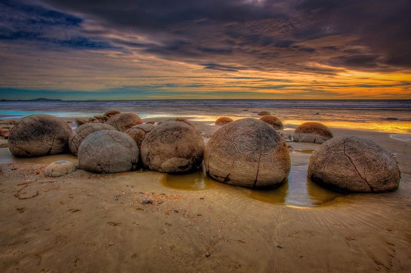 Visit New Zealand and Moeraki Boulders on the Beach