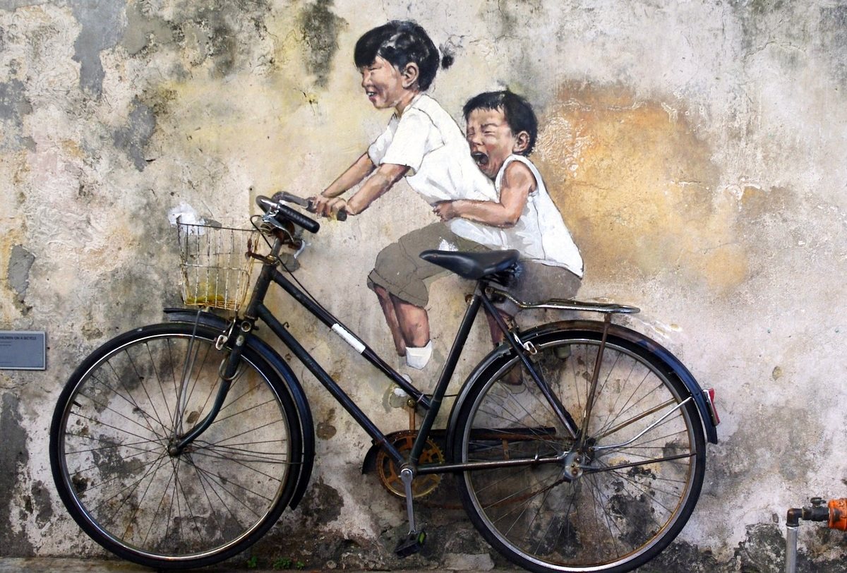 unique places in penang | famous Street art children on bicycles