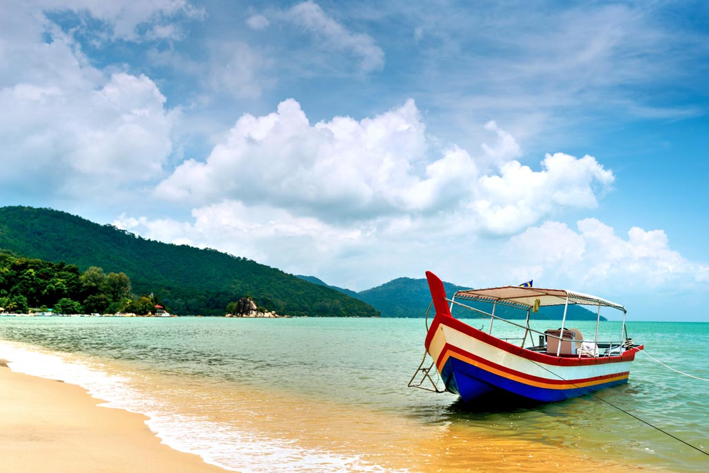 penang tourist attractions | colourful boat on beach