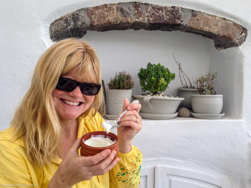 eat yogurt for breakfast in santorini