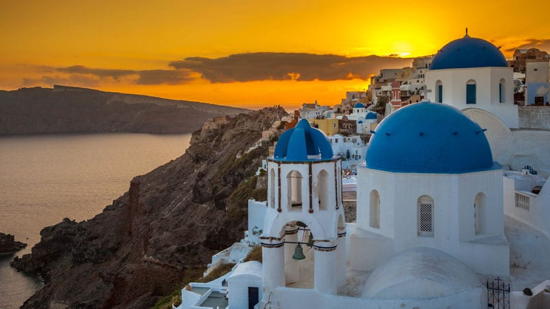 sunset over blue domes things to see in santorini