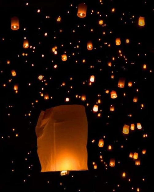 yi peng festival lanterns in sky thailand