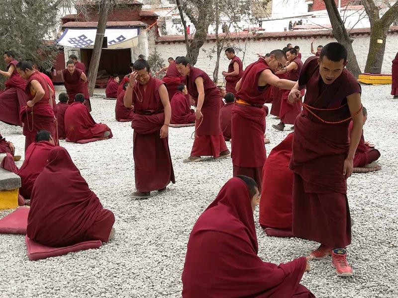 monks debating Buddhism in Tibet monastery