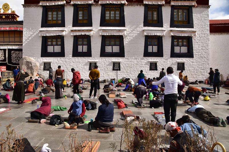 people praying at Jokhang  temple