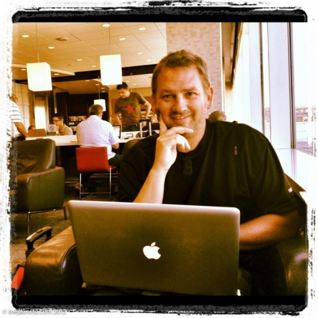 working on the travel blog in the airport
