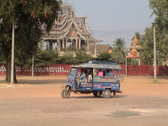 tuk tuk drives in downtown Vientiane