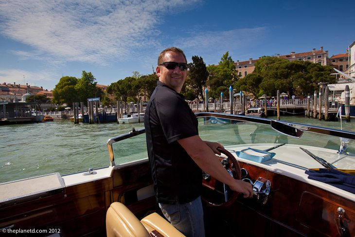 Travel Blogger Dave takes over driving the boat in Venice