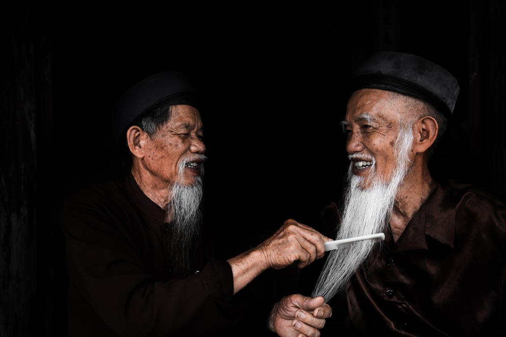 man combing beard vietnam travel highlights