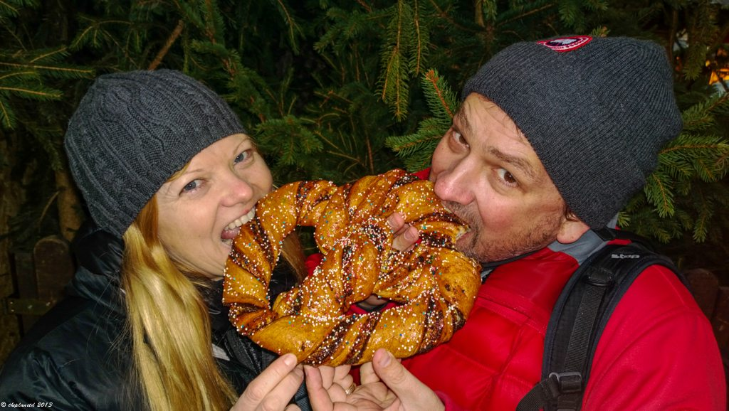 Eating a Giant Pretzel in the Christmas Market of Vienna