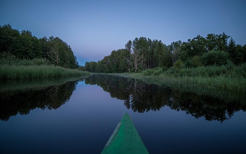 visit estonia canoe at night