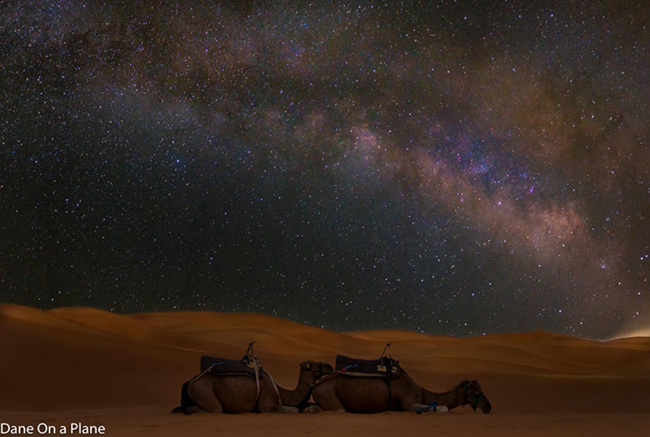 visit morocco in photos milky way over desert desert