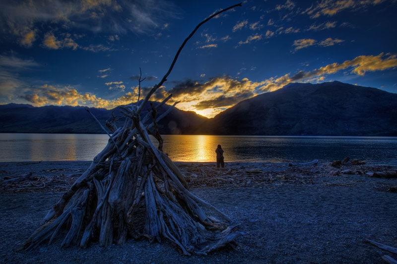 visit new zealand beach sunset