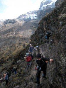 woman climbing western breach mount kilimanjaro