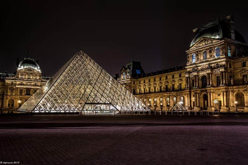 where to stay in paris | louvre at night arrondissement 1