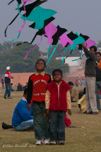 kids look up at kites in Jaipur India