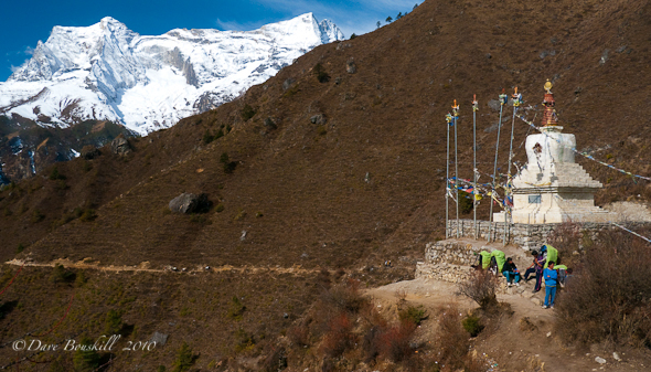 Sherpas rest at Tenzing Norgay Monument on Route to Everest