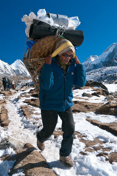 Sherpas carry heavy load through Himalayas