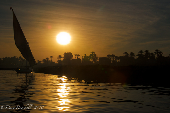 Feluca sails on Nile River at Sunset